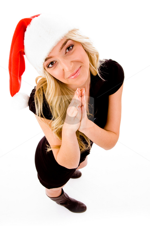 Top view of praying female wearing christmas hat stock photo, Top view of praying female wearing christmas hat on an isolated background by Imagery Majestic