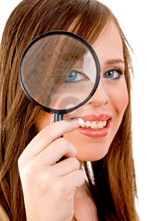 Front view of woman looking through lens stock photo, Front view of woman looking through lens on an isolated background by Imagery Majestic