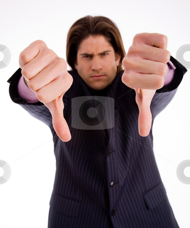 Man wearing suit with thumbs down stock photo, Front view of professional with thumbs down on an isolated white background by Imagery Majestic
