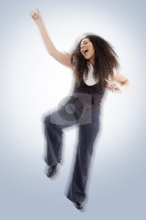 Blur image of young happy female stock photo, Blur image of young happy female dancing by Imagery Majestic