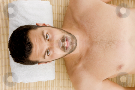 High angle view of man receiving hot stone massage  stock photo, High angle view of man receiving hot stone massage by Imagery Majestic