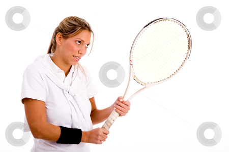 Side view of woman playing tennis stock photo, Side view of woman playing tennis against white background by Imagery Majestic