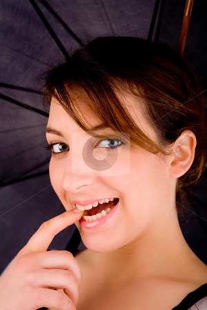 Front view of happy woman with umbrella stock photo, Front view of happy woman with umbrella by Imagery Majestic