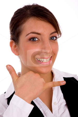 Front view of cheerful woman making phone call hand gesture stock photo, Front view of cheerful woman making phone call hand gesture on an isolated white background by Imagery Majestic