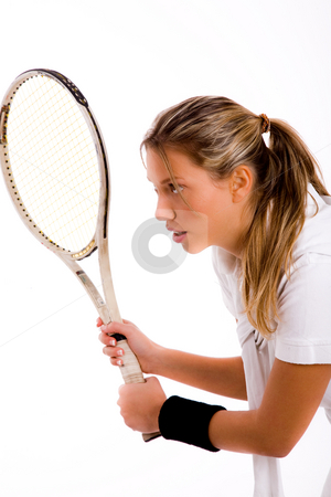 Side pose of young tennis player stock photo, Side pose of young tennis player on an isolated background by Imagery Majestic
