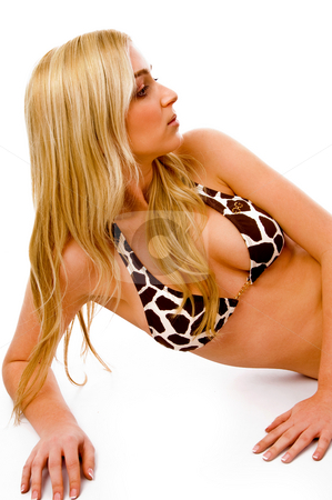 Side view of laying sensuous female in bikini stock photo, Side view of laying sensuous female in bikini with white background by Imagery Majestic