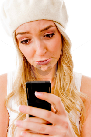 Portrait of young woman looking the cell phone stock photo, Portrait of young woman looking the cell phone against white background by Imagery Majestic