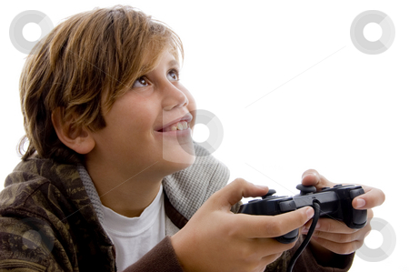 Teen playing video games stock photo, Side view of young boy playing video ...