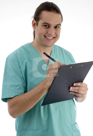 Handsome surgeon writing prescription stock photo, Handsome surgeon writing prescription with white background by Imagery Majestic