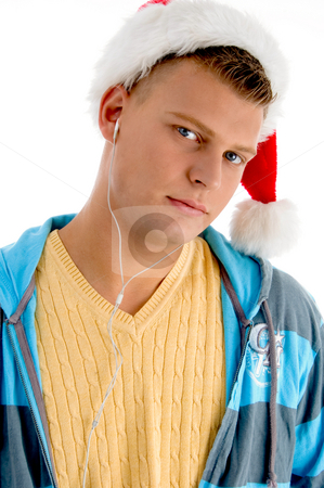 Handsome man wearing christmas hat stock photo, Handsome man wearing christmas hat with white background by Imagery Majestic