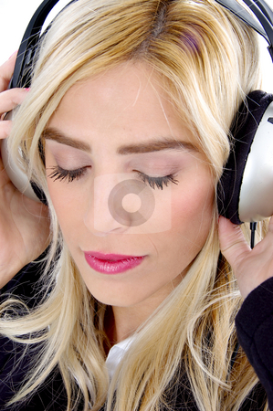 Close view of woman tuned in music stock photo, Close view of young woman tuned in music by Imagery Majestic