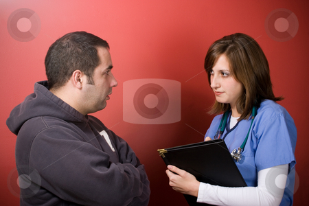 At the Doctors Office stock photo, A young nurse talks to a patient during his visit. by Todd Arena