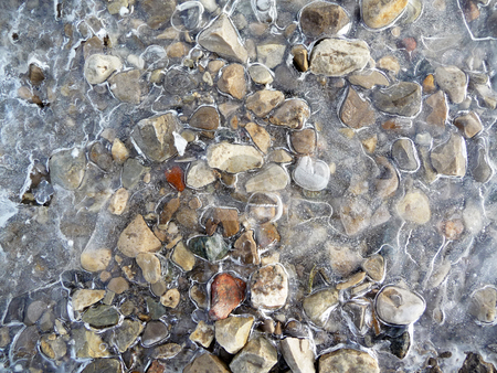 Gravel encased in ice stock photo,  by J.G. Byers