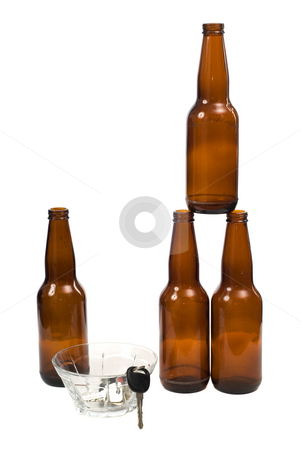 Designated Driver stock photo, A designated driver placed his keys into a glass bowl, with empty beer bottles beside them by Richard Nelson