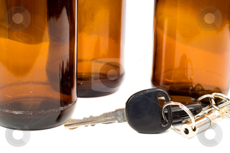 Drinking And Driving Concept stock photo, Concept image of drinking and driving with a shot of some car keys beside some empty beer bottles by Richard Nelson