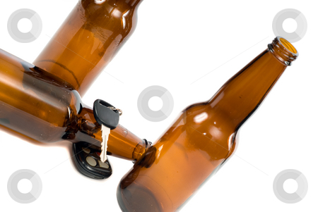 Dangerous Driving stock photo, Dangerous driving habits by drinking and then driving, shot against a white background by Richard Nelson