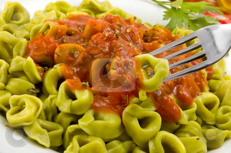 Tortellini with tomato sauce. stock photo, Plate of italian tortellini with tomato sauce. by Pablo Caridad