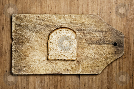 Slice of wholemeal bread. stock photo, Slice of wholemeal bread on a table. by Pablo Caridad