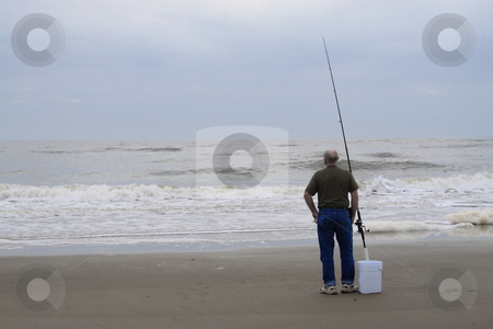 Surf Fishing stock photo, Fisherman surf fishing on the coast of Tybee Island Savannah GA by Jack Schiffer