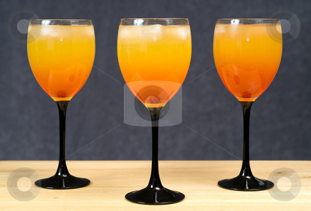 Alcoholic Drinks stock photo, Three alcoholic drinks shot on a wooden counter by Richard Nelson