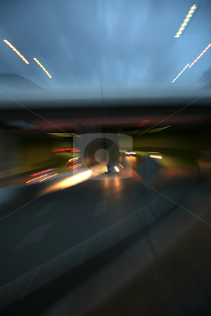 Traffic blur stock photo, Traffic blur from slow shutter speed and winding lens by DAVID HILCHER