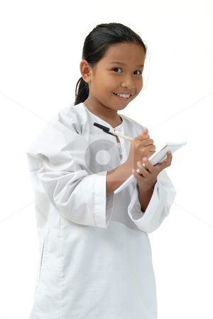 School Girl write in note stock photo, School Girl write in note and smile by Jaggat Images