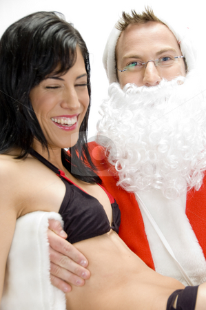 Sexy lady with santa man stock photo, Sexy lady with santa man with white background by Imagery Majestic
