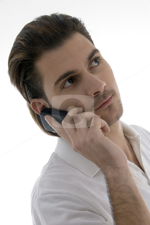Young man talking on the cellphone stock photo, Young man talking on the cellphone on an isolated white backgound by Imagery Majestic