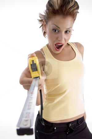 Female with measurement tape stock photo, Female with measurement tape on an isolated background by Imagery Majestic