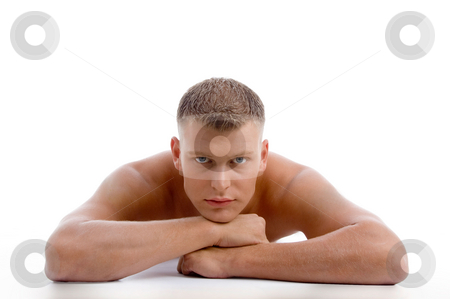 Laying muscular male looking at you stock photo, Laying muscular male looking at you on an isolated white background by Imagery Majestic