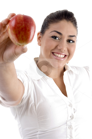 Smiling young female showing apple stock photo, Smiling young female showing apple on an isolated background by Imagery Majestic