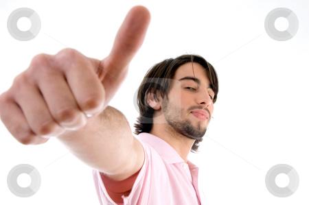 Brunette man wishing goodluck stock photo, Brunette man wishing goodluck on an isolated white background by Imagery Majestic