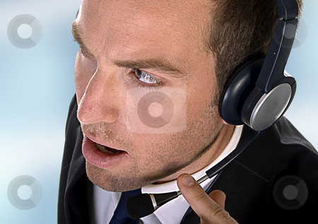Young businessman with headphones stock photo, Young businessman with headphones on an abstract background by Imagery Majestic