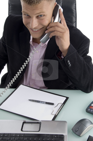 Smiling lawyer talking on phone stock photo, Smiling lawyer talking on phone on an isolated background by Imagery Majestic
