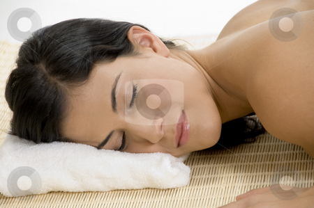 Young woman sleeping on mat stock photo, Young woman sleeping on bamboo mat on an isolated white background by Imagery Majestic