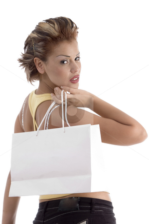 Woman with shopping bag stock photo, Woman with shopping bag on an isolated background by Imagery Majestic