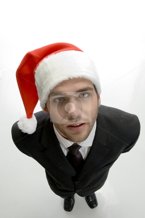Businessman with santa cap stock photo, Businessman with santa cap against white background by Imagery Majestic
