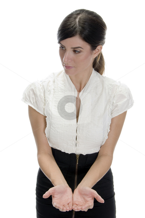 Young lady showing her palms stock photo, Young lady showing her palms against white background by Imagery Majestic
