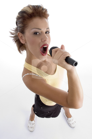 Sexy woman singing in microphone stock photo, Sexy woman singing in microphone on an isolated background by Imagery Majestic