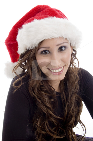 Smiling woman wearing christmas hat stock photo, Smiling woman wearing christmas hat against white background by Imagery Majestic