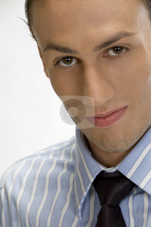 Young businessman posing stock photo, Close up young businessman posing by Imagery Majestic