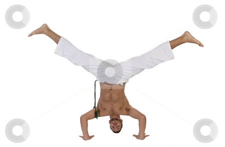 Young caucasian doing cartwheel stock photo, Young caucasian doing cartwheel against white background by Imagery Majestic