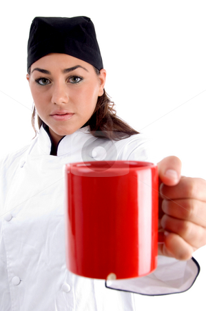Chef showing you coffee mug stock photo, Chef showing you coffee mug against white background by Imagery Majestic