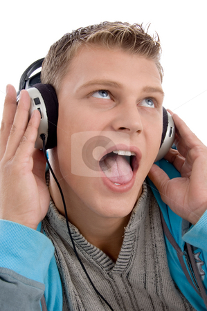 Man listening through headphone stock photo, Man listening through headphone against white background by Imagery Majestic