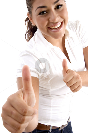Smiling woman showing good luck sign stock photo, Smiling woman showing good luck sign with white background by Imagery Majestic