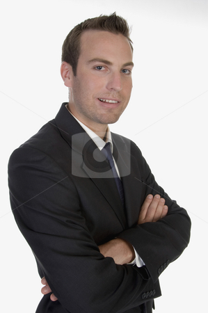 Young businessman posing stock photo, Young businessman posing on an isolated white background by Imagery Majestic