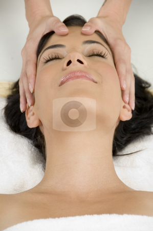 Young pretty woman getting head massage stock photo, Young pretty woman getting head massage by Imagery Majestic