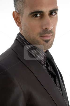 Side pose of businessman stock photo, Side pose of businessman on an isolated background by Imagery Majestic