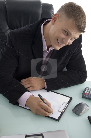 Working handsome businessman  stock photo, Working handsome businessman on an isolated background by Imagery Majestic