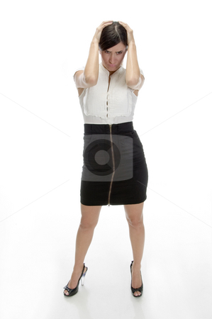 Young woman in frustration stock photo, Young woman in frustration on an isolated background by Imagery Majestic
